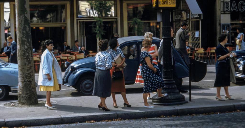 Women waiting on median
